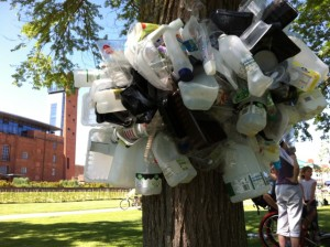 "On Saturday 26 May 2012 we created scupltures from the plastic collected during the Plastic Challenge fortnight. This shows a plastic ""growth"" on a tree on the Bancroft Gardens, Stratford upon Avon, with the Royal Shakespeare Theatre in the background"
